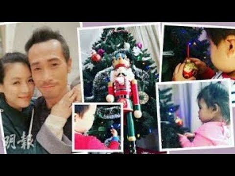 Moses Chan decorates the Christmas tree with his family