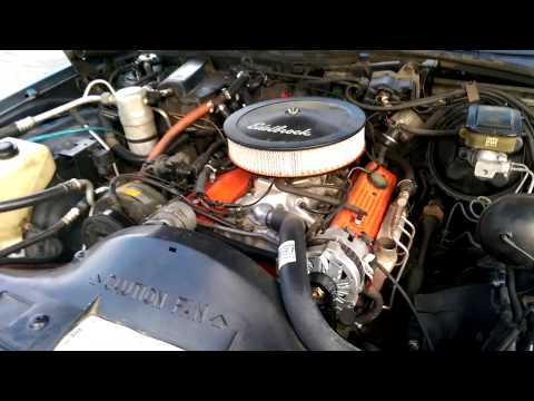 Repeat Chevy 305 with a little cam New Holley tbi intake by
