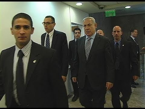 Israeli Prime Minister Benjamin Netanyahu, surrounded by security guards