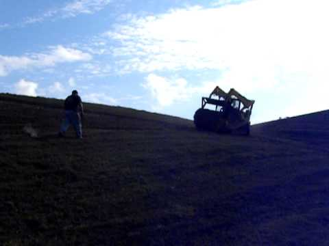 Laying sod rolls on a slope