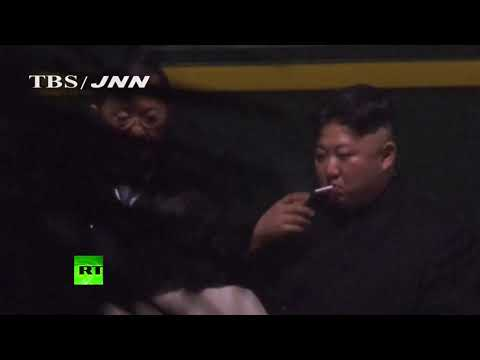 Kim seen smoking cigarette at China train station hours before arriving in Vietnam