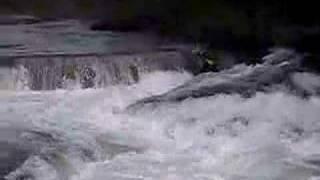 Riverboarding a diversion dam