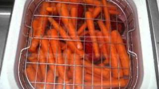Ultrasonic washer cleaning carrots and beets after preliminary washing