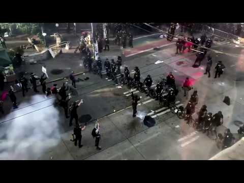Seattle police use flash bangs to move protesters on street