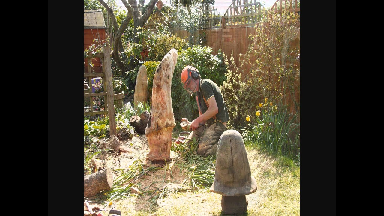Chainsaw Carving Old Apple Tree Stump Into Toadstools