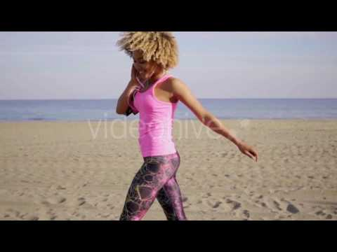 Download Happy Woman Dancing At Beach - Stock Footage | VideoHive 15478765