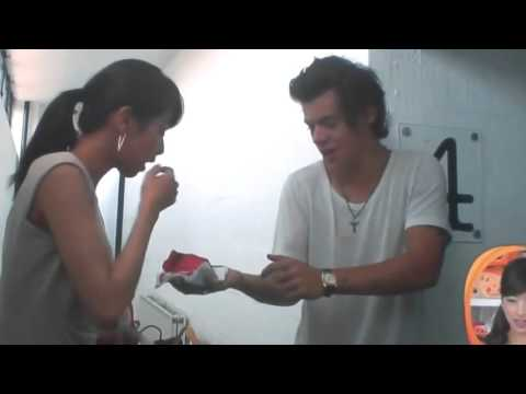 Harry offers cake to the interviewer