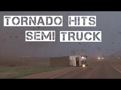Randi West - Storm trackers come up on semi truck flipped over by tornado