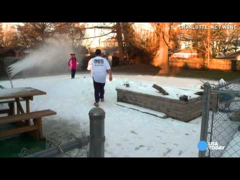 Fake snow machine creates winter fun in man's backyard
