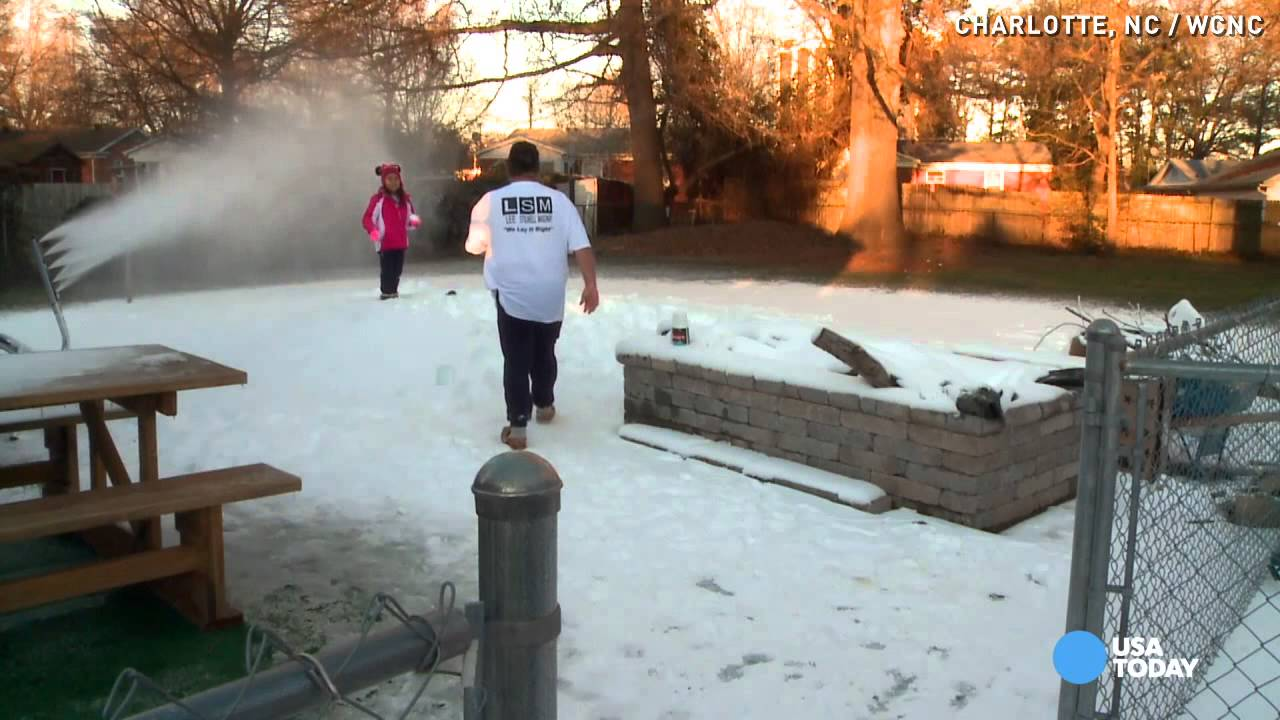 Fake snow machine creates winter fun in man s backyard