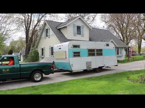 Ford Ranger EV Electric Pickup Truck pulls blue travel trailer