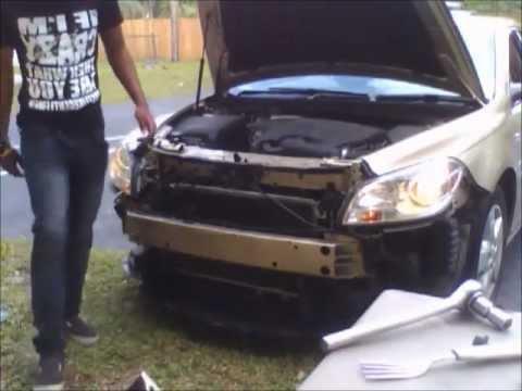 Changing the headlanp on a Chevy Malibu 2008 - YouTube