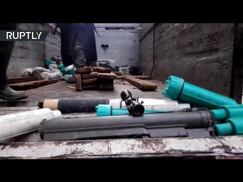 Militant's bombs, gas masks, black jackets: SAA carry out clean up operation in eastern Aleppo