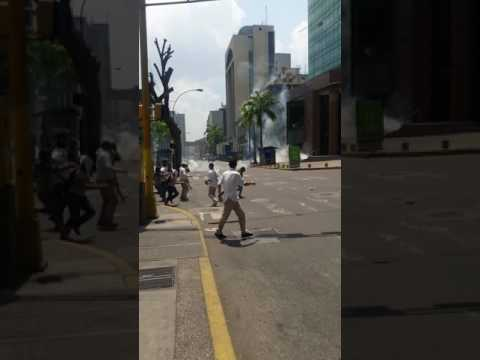 Demonstrators Flee From Tear Gas As Caracas Protests Mount