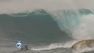 Massive waves capsize boat at Jaws