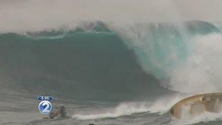 Massive waves capsize boat at Jaws