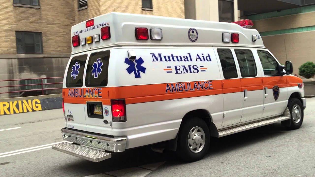 MUTUAL AID EMS AMBULANCE LEAVING UPMC PRESBYTERIAN HOSPITAL IN PITTSBURGH,  PENNSYLVANIA