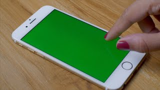 Green Screen - A woman scanning pictures gallery on her new smartphone