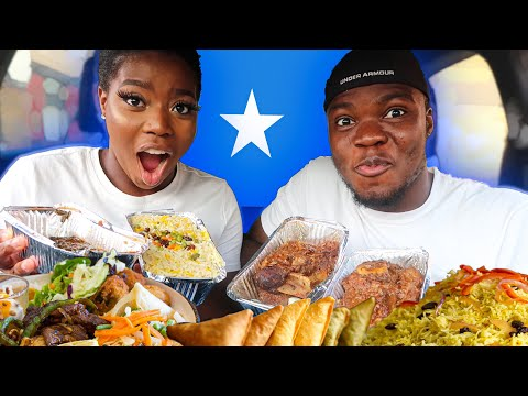 Nigerians trying Somali food for the first time