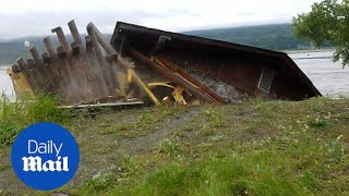 Family watches in horror as cabin COLLAPSES into river in Alaska - Daily Mail