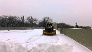 Protech Snow Pusher Clearing Parking Deck