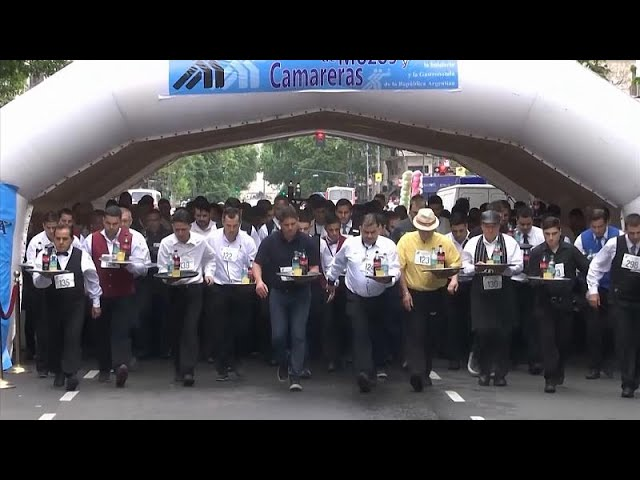 Argentine waiters race to the finish line during annual competition