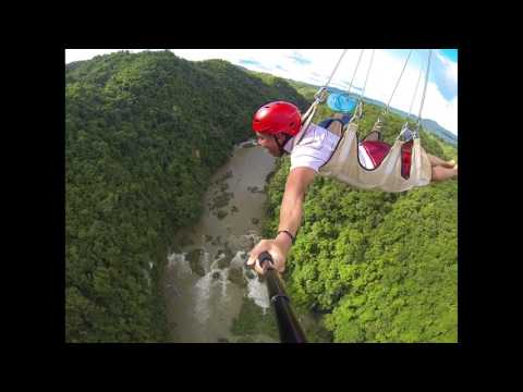 Philippines Zip Lining over forest and river. Bohol Adventure Park.