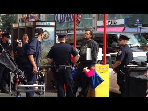 NYPD BREAKING UP A HEATED ARGUMENT ON WEST 125TH STREET IN THE HARLEM, MANHATTAN IN NEW YORK CITY.