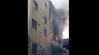 South Korean mom throwing kids from building on fire, Watch video | Oneindia News