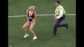 Kinsey Wolanski running half-naked on the pitch during the game in the Champions League