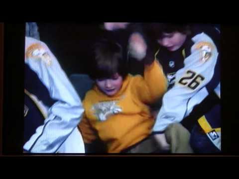 Kid gets stuck upside down in his seat at hockey game