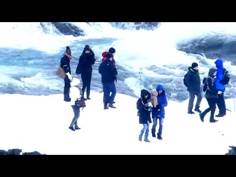 Iceland. Unnecessary risky tourists At Gullfoss waterfall