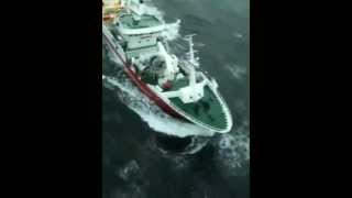 Irish Coast Guard Helicopter watches progress of trawler in the Atlantic Ocean