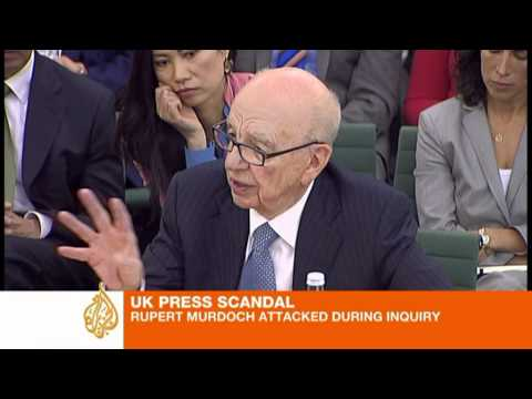 Murdoch denies blame for hacking scandal
