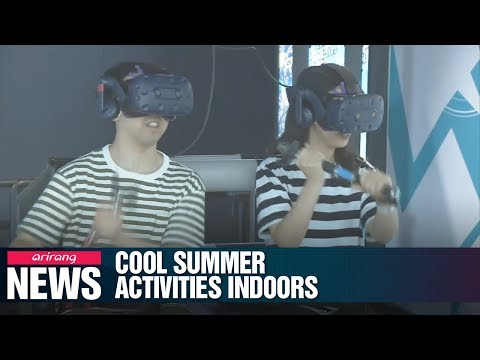 Koreans keeping cool this summer at special movie theaters, VR theme parks