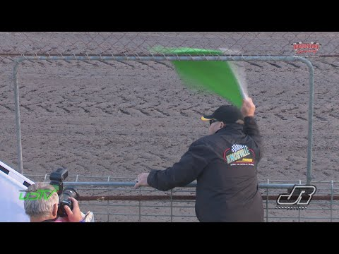 Knoxville Raceway flagman Justin Clarke waving the flags at Borderline Speedways Kings Challenge