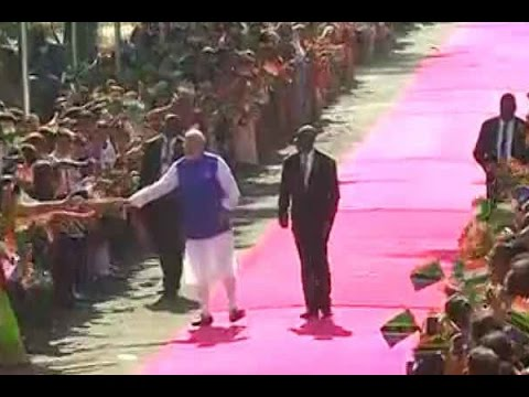 Children wave India and Tanzania flags as they welcome PM Narendra Modi in Dar es Salaam