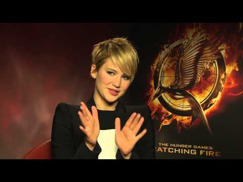 Jetlagged Jennifer Lawrence nearly falls asleep during Hunger Games Catching Fire junket interview