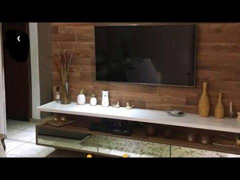 assentamento de porcelanato que  imita madeira na parede da sala painel fabio123