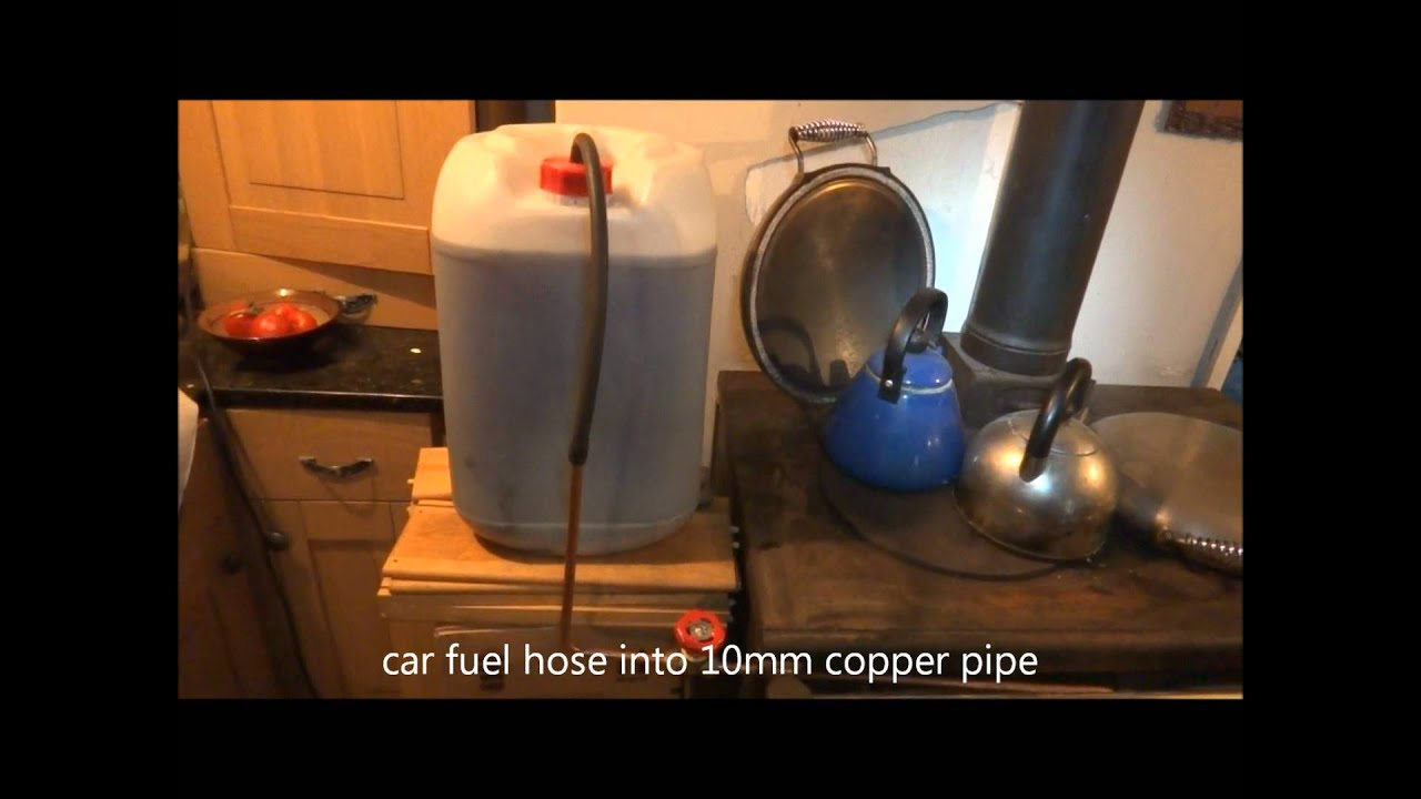 Ozzirt Waste Oil Heater In Wood Stove Youtube