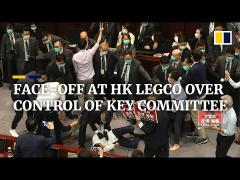 Scuffles at Hong Kong's Legislative Council over control of House Committee meeting