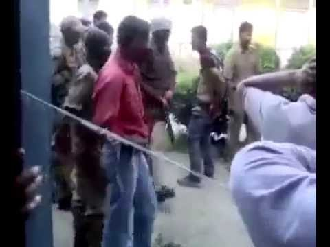 Indian army beating Kashmiri youth brutely