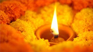 Diwali festival - closeup shot of decoration with diya and marigold flowers