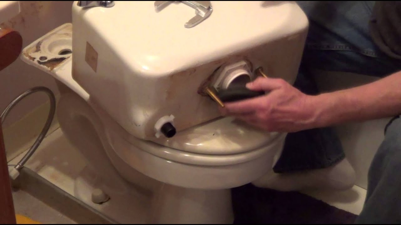 replacing toilet tank parts.  How to Replace a Toilet Flush Valve Tank Bowl Leak YouTube