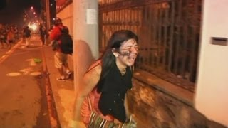 Protesters clash with police near the Maracana stadium in Rio de Janeiro