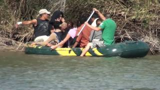 Immigrants crossing the Rio Grande river
