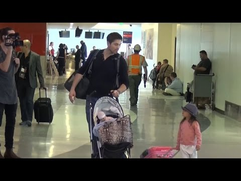 Adorable Family, Roselyn Sanchez, Eric Winter, And Daughter Pass Through LAX