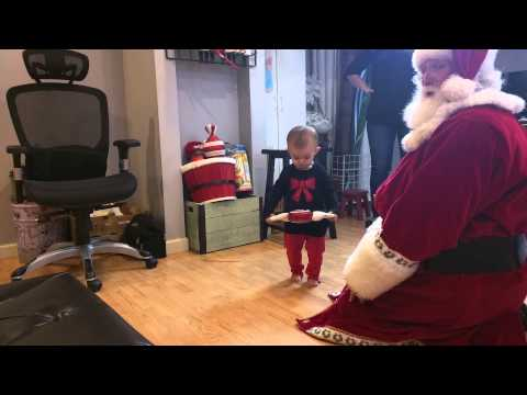 Santa singing to Avery and Aubrey