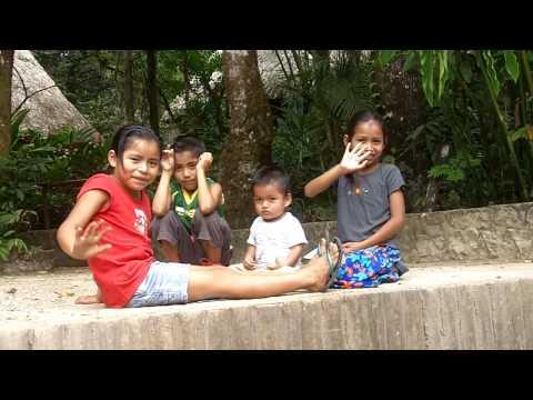 Guatemalan children waving goodbye