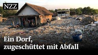 Ein Dorf, zugeschüttet mit Plastikmüll und anderem Abfall